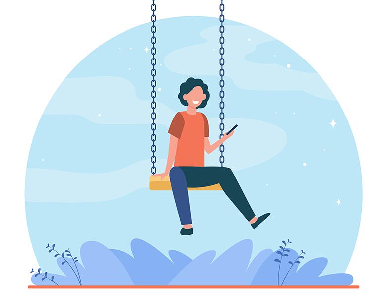 Happy kid sitting on swing